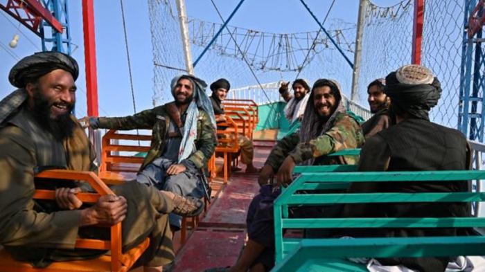 Taliban fighters hit a Kabul fairground as Afghans fear for freedoms -   NO COMMENT