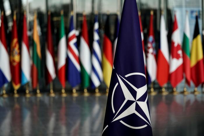NATO expels eight