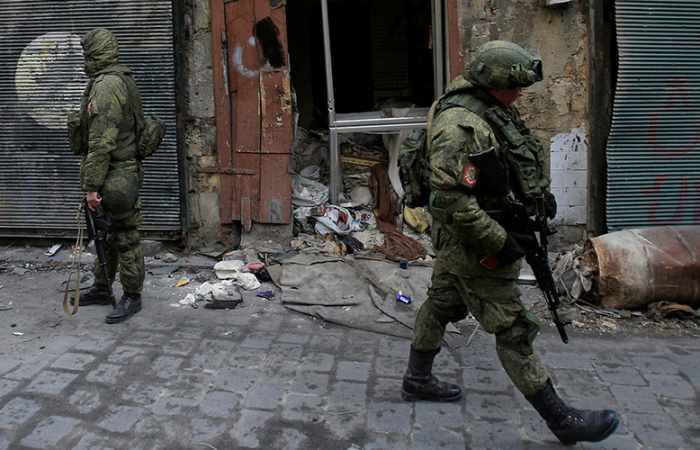 Russian military adviser killed in attack on Syrian govt camp