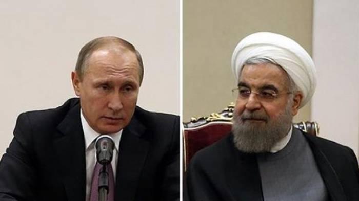 Putin spricht mit Rohani