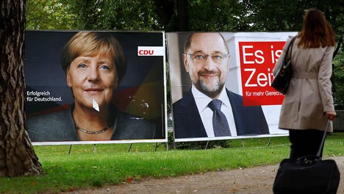 Merkel intenta formar una coalición, mientras que los alemanes no quieren verla en nuevas elecciones