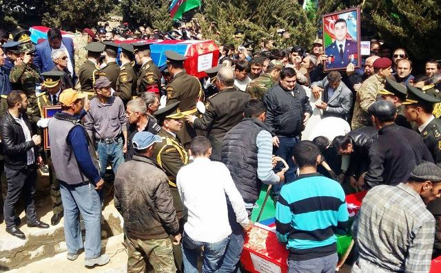 Azerbaijani military pilots and officer martyred on contact line laid to rest