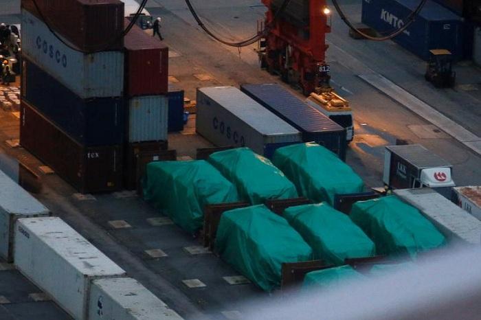Beijing warns against Taiwan ties as Singapore tries to free troop carriers in Hong Kong