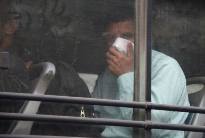 India bus passenger arrested over smelly socks