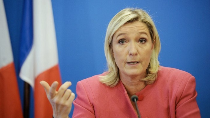 Le Pen demands removal of EU flag for TV interview