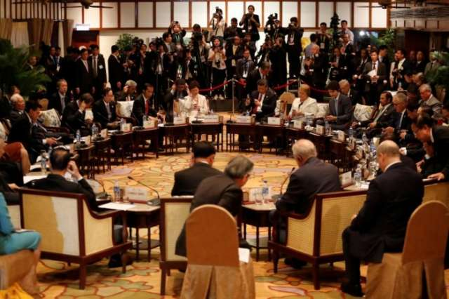 APEC ministers publish joint statement after wrangling over language