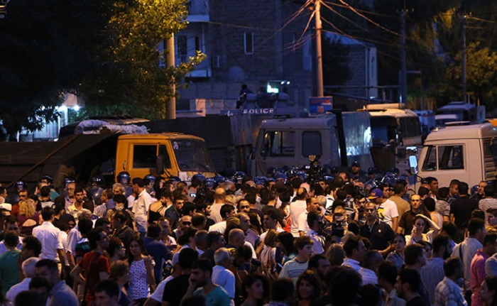 What special means did Armenian police use against protesters?