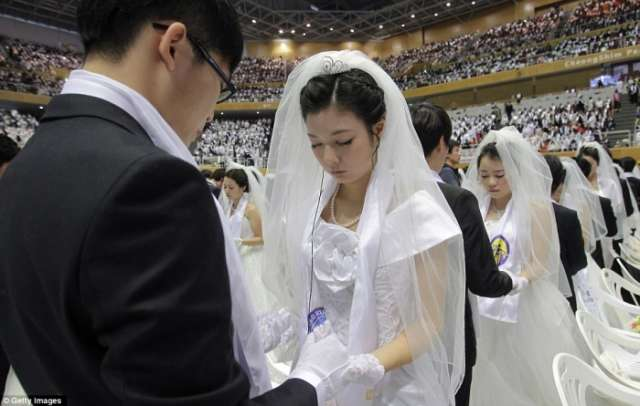 Unification church couples over the moon at mass wedding - NO COMMENT