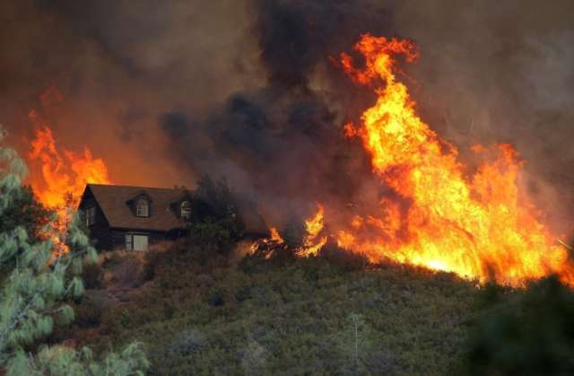 California wildfires burn with little containment as conditions worsen