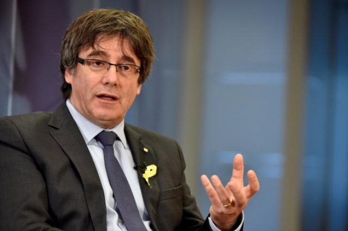 Catalonia's Puigdemont seeks to vote by proxy for comeback bid: source