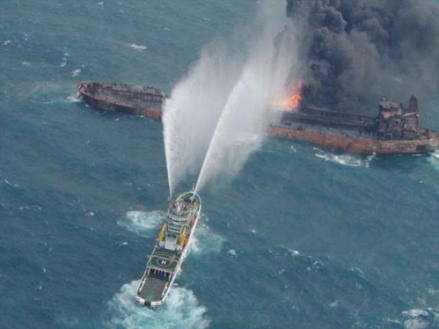 Chinese salvagers recover two bodies from flaming Iranian tanker