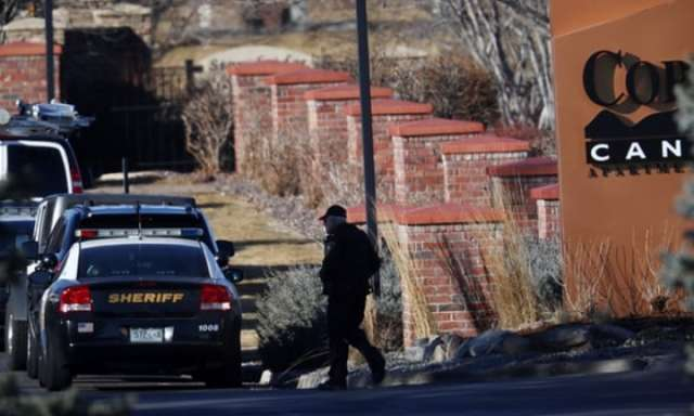 Colorado police officer shot dead and four others wounded in 'ambush-style attack'