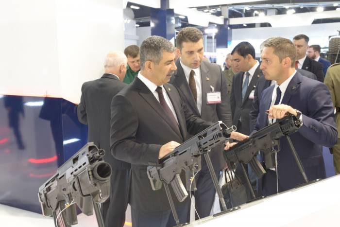 Azerbaijani defense minister attends int'l defense industry exhibition in Poland - PHOTOS