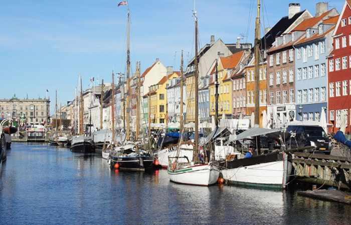 Denmark under fire for keeping unspent refugee money