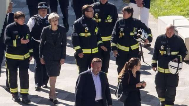 May 'distraught as we all are' about Grenfell fire