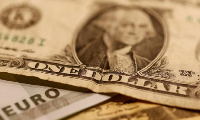 Dollar inches lower as attention turns to Fed