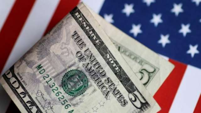 Dollar advances after strong U.S. data, Fed minutes