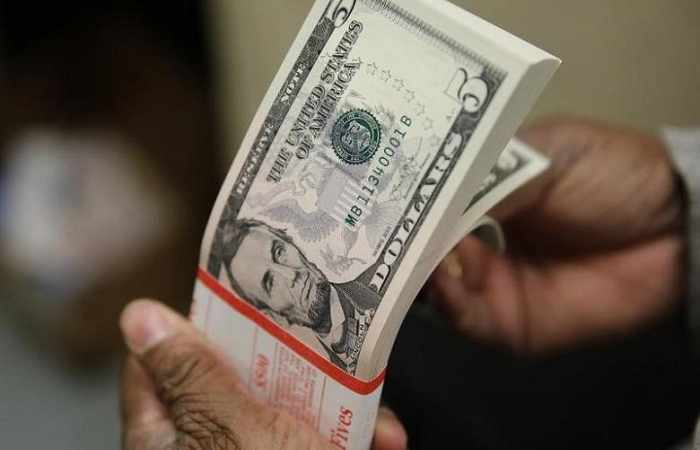 Dollar slips on fears over U.S. tax reform