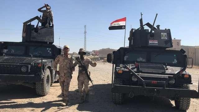 Iraqi army retakes strategic border crossing with Syria