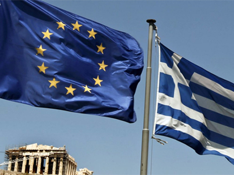 Euro zone to unlock new loans to Greece, working on debt relief