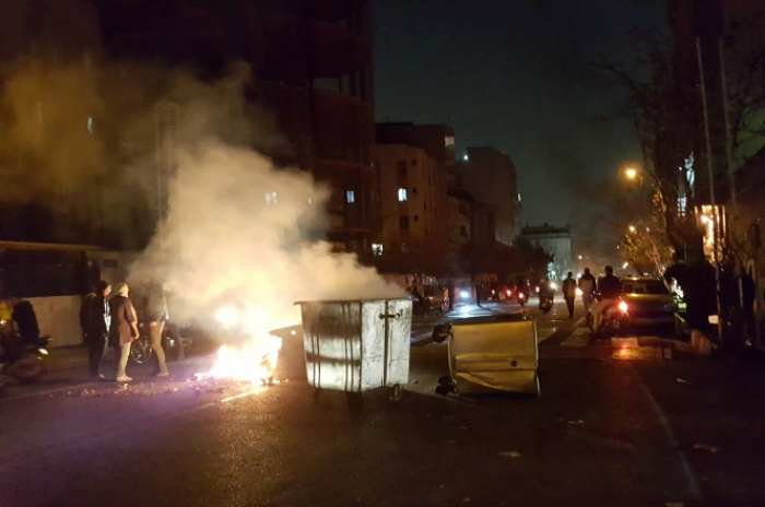 2 reportedly killed as mass protests in Iran turn violent