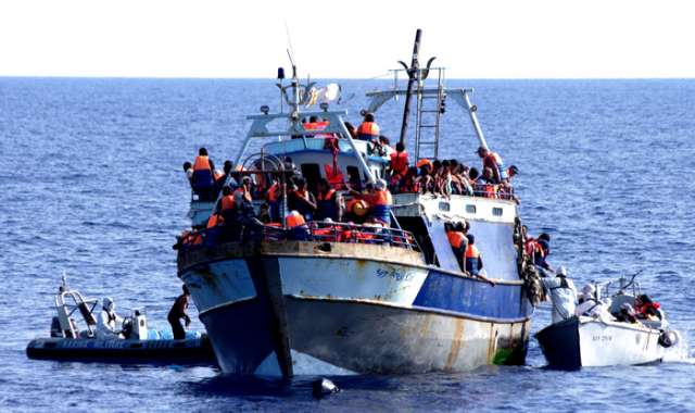 Migrants build makeshift camp on Spain