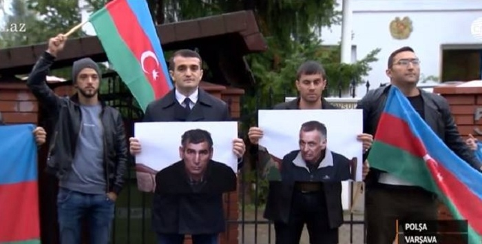 Azerbaijani hostage's son holds protest in Warsaw