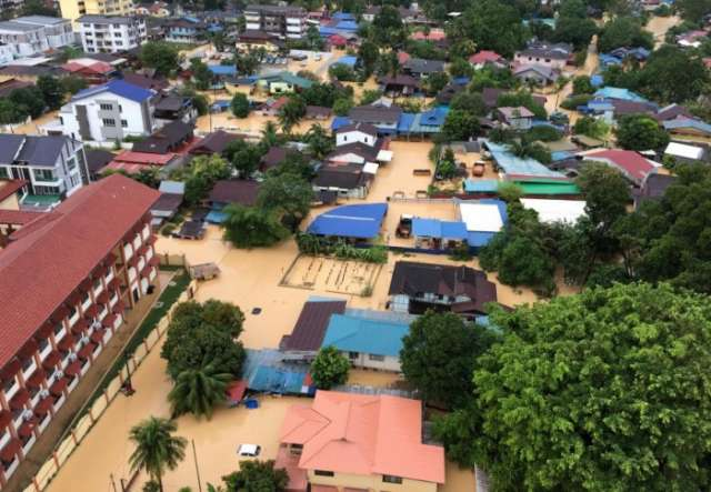 Flash floods kill five in Malaysia, army deploys to rescue thousands of displaced