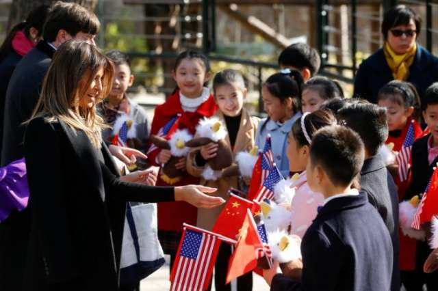 First lady Melania plays tourist as Trump departs Beijing