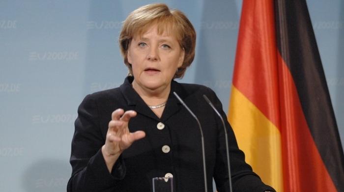Merkel starts new talks to form government