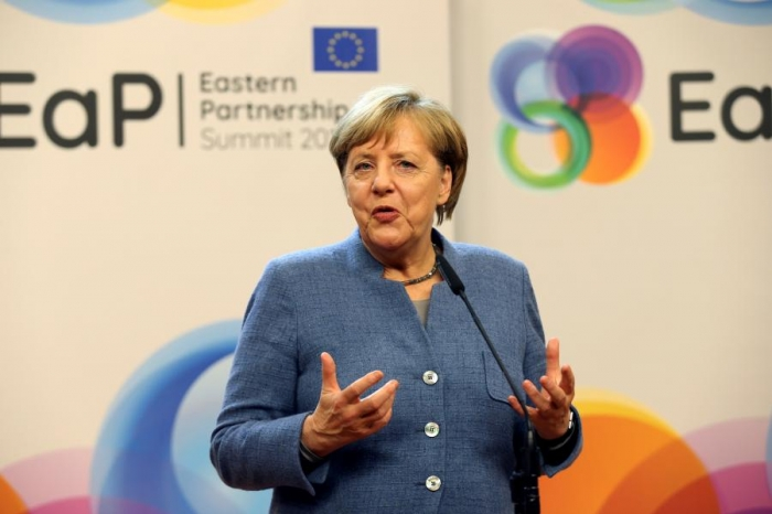 Germany's Merkel vows to get government in place quickly