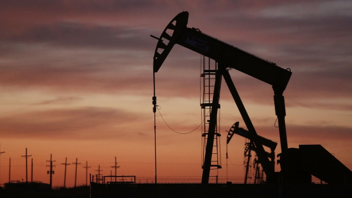 Oil prices inch lower on increases in U.S. crude inventories, production