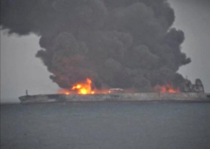 Rescue crews struggle to tame China oil tanker fire; crew still missing