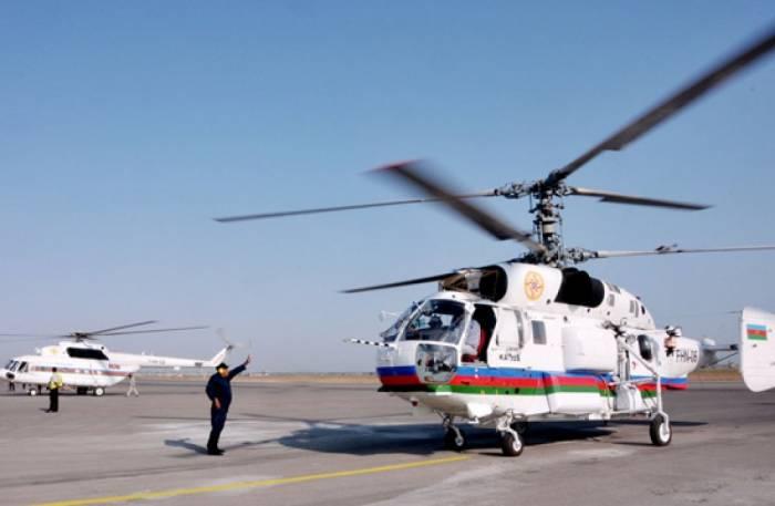 FHN-in helikopteri Gürcüstandakı yanğını söndürür