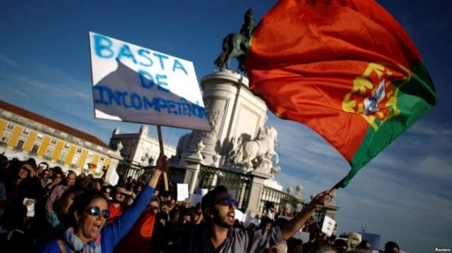 Portuguese protest over deadly forest fires, government pledges aid