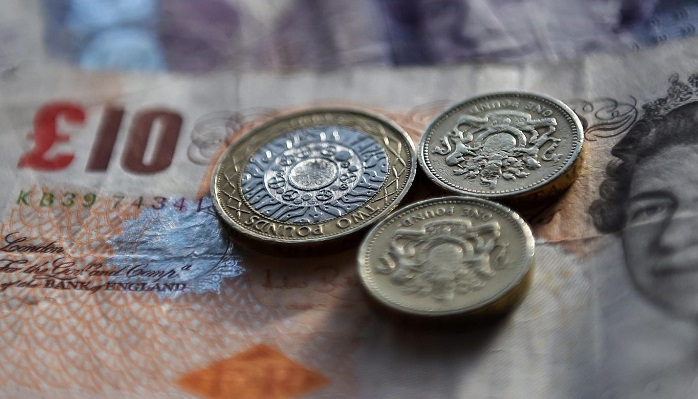 Pound sterling slumps against dollar and euro after slew of bad news