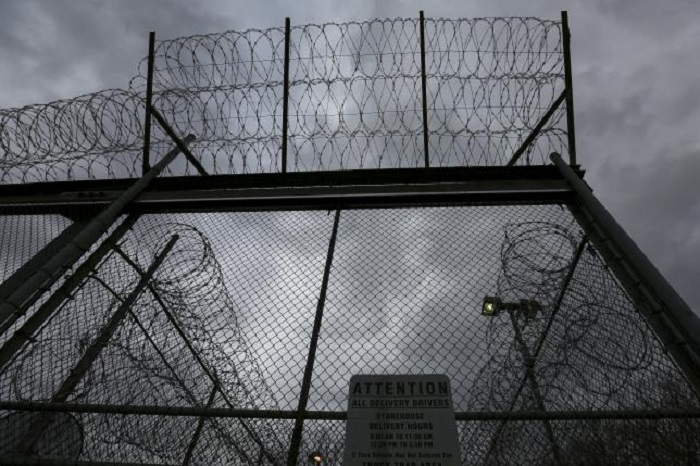 One prison at Guantanamo closes, detainees remain