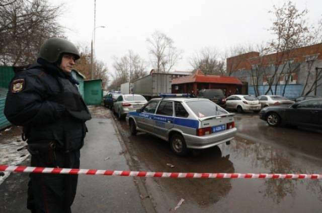 Russian police seize ex-factory owner who fled after shooting