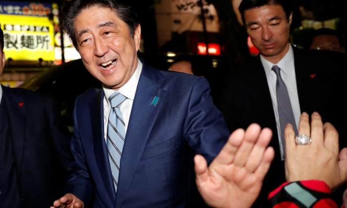 Exit polls suggest Japan PM Shinzo Abe wins victory in Sunday's election