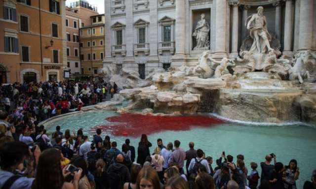 Rome's Trevi fountain turns red after activist uses dye to protest 'corruption'