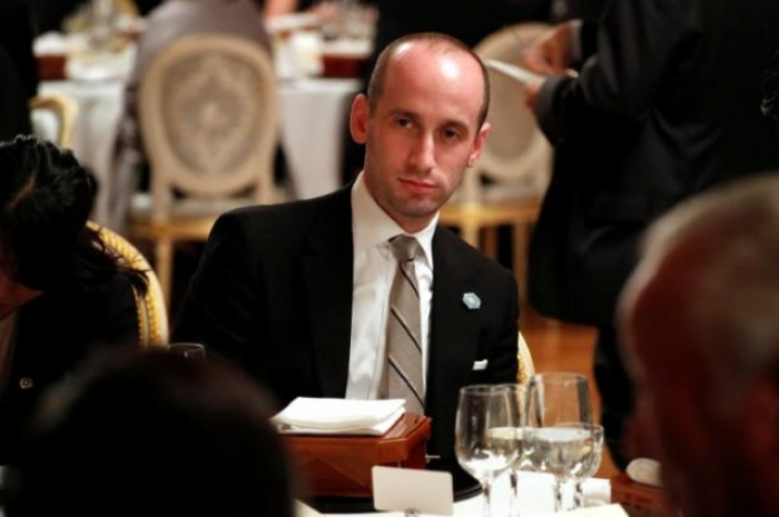 Furious Trump aide assails book, calls president a 'genius'