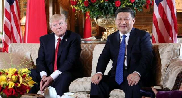 Trump tells China's Xi he believes there is solution to North Korea