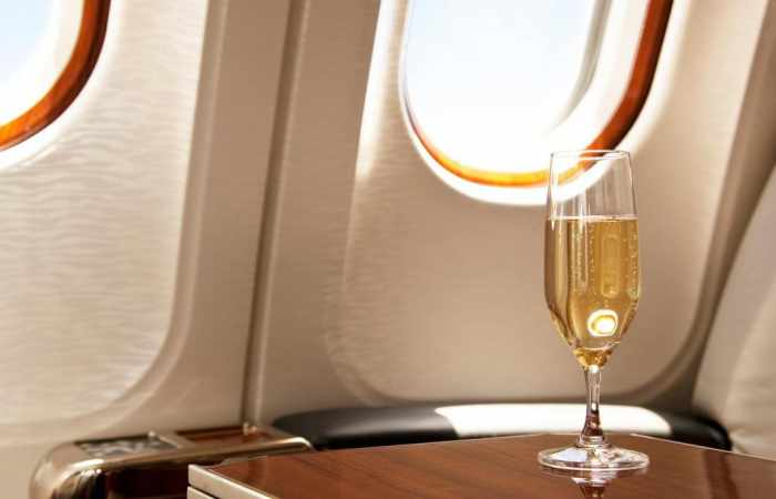 Why should you  always choose wine instead of coffee when flying?