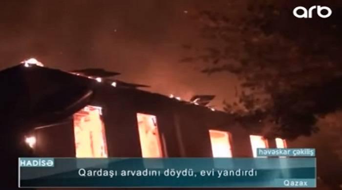 Qardaşı arvadını çəkiclə döyüb evi yandırdı - Video